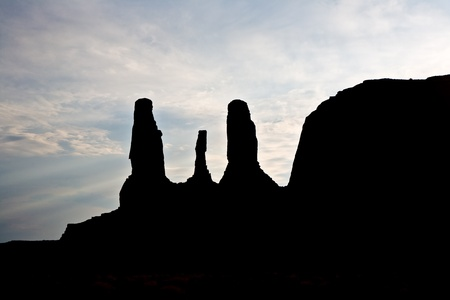 The Buttes three sisters are a giant sandstone formations in the Monument valley made of sandstone photo