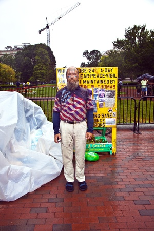 WASHINGTON, USA - JULY 14: man is demonstration in front of the white house in rain for peace and against nuclear wapons and stays there in his tent  on July 14,2010 in Washington, USA. Stock Photo - 9531983
