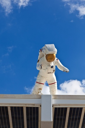 space suit: ORLANDO, USA - JULY 25: an Astronaut in his Space suit is watching the entrance of the Kennedy space center  on July 25, 2010 in Orlando, USA.