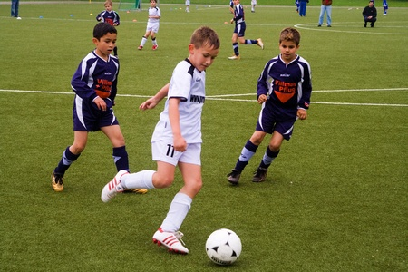 kids football: WALLAU, GERMANY - MAY 19: Football game Children E-Class Tournament - BSC Schwalbach against FC WALLAU , May 19, 2007 in Wallau, Germany. Children in teckling to win the ball. Editorial