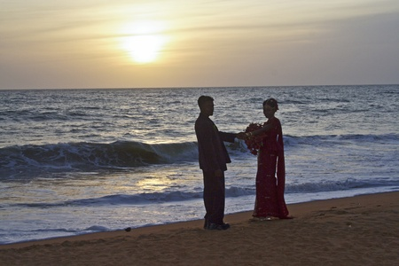 COLOMBO,  SRI LANKA - JUL 30:  Married couple  at the beach with the bridal flowers on their wedding day in sunset in Love on July 30, 2005 in Colombo, Sri Lanka.