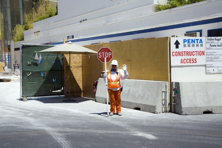 regulating: LAS VEGAS,  USA - JULY 18: Woman assecurity guard is regulating the access to the construction site on July 18,2008 in Las Vegas, USA. Editorial