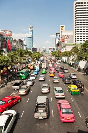 BANGKOK, THAILAND - December 22: main road in Bangkok in afternoon traffic jam with cars near the CENTRAL shopping center, Sukhumvit December 22,2009,Bangkok, Thailand