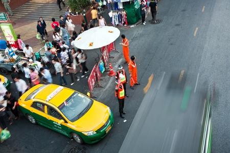 BANGKOK, THAILAND - JANUARY 5: Security Guard at the main road is regulating the traffic and the passengers at the bus station, Sukhumvit Road,  January 5, 2010 in Bangkok, Thailand Stock Photo - 9532286