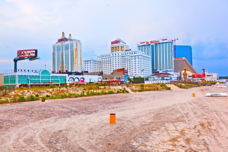 ATLANTIC CITY - JULY 13: Boardwalk in the evening in Atlantic City  on July 13, 2010 in Atlantic Sity, USA. The town is  a nationally renowned resort city for gambling, shopping and fine dining. Stock Photo - 9532246