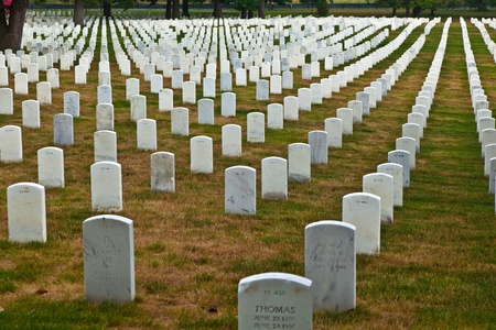 national military cemetery: WASHINGTON, USA � JULY 15: view in afternoon sun to the graves and tombstones of Arlington national Cemetery  on July 15,2010 in Washington, USA.