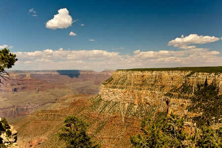view from Maricopa Point to the Grand Canyon to North Rim, shadow of clouds on the rock face photo