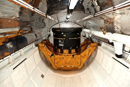 cape canaveral: ORLANDO, USA - JULY 25: inside the space shuttle Explorer with a satellite as load in the belly  on July 25, 2010 in Orlando, USA.