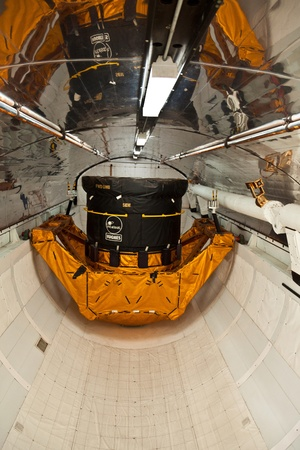 ORLANDO, USA - JULY 25: inside the space shuttle Explorer with a satellite as load in the belly  on July 25, 2010 in Orlando, USA.