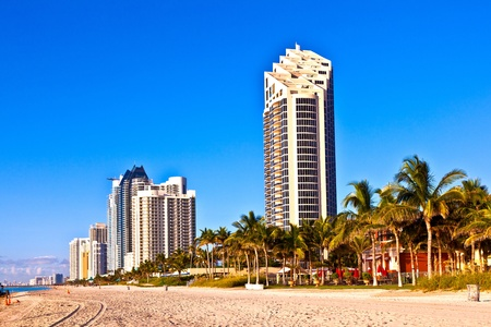 MIAMI, SUNNY ISLAND USA - JULY 28: View to promenade of Sunny Islands and New Skyscraper in early morning  on July 28, 2010.  Michael Dezer has invested heavily in construction of high-rise hotels and condominiums while licensing the Donald Trump name. Stock Photo - 9532253