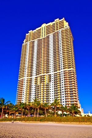 MIAMI, SUNNY ISLAND USA - JULY 28: View to promenade of Sunny Islands and New Skyscraper in early morning  on July 28, 2010.  Michael Dezer has invested heavily in construction of high-rise hotels and condominiums while licensing the Donald Trump name.