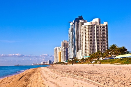 licensing: MIAMI, SUNNY ISLAND USA - JULY 28: View to promenade of Sunny Islands and New Skyscraper in early morning  on July 28, 2010.  Michael Dezer has invested heavily in construction of high-rise hotels and condominiums while licensing the Donald Trump name.