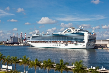 cruiseship: FORT LAUDERDALE, USA - AUGUST 1: Cruiseship Emerald Princess is on the pier on August 01, 2010 in Fort Lauderdale, USA. Launched in 2007, Emerald Princess with 900 balcony staterooms is one of the largest cruise ship in the world.