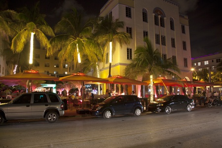 MIAMI BEACH, USA - August 02: Night view at Ocean drive on August 02,2010 in Miami Beach, Florida. Art Deco Night-Life in South Beach is one of the main tourist attractions in Miami. Stock Photo - 9532075