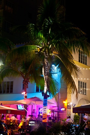 tourist attractions: MIAMI BEACH, USA - August 02: Night view at Ocean drive on August 02,2010 in Miami Beach, Florida. Art Deco Night-Life in South Beach is one of the main tourist attractions in Miami.