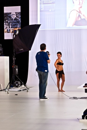 PHOTOKINA, COLOGNE - SEPTEMBER 25: Photokina - World of Imaging, Top Event for the Trade and User, fotoshooting for visitors,September 25, 2010 in Cologne, Germany. Stock Photo - 9531924