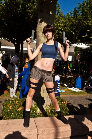 croft: FRANKFURT, GERMANY - OCTOBER 10: Public day at Frankfurt international Book Fair, girl made up as Lara Croft and poses for photografers on October 10, 2010 in Frankfurt, Germany.