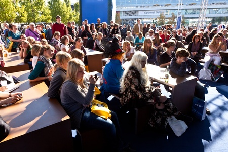 FRANKFURT, GERMANY - OCTOBER 10: Public day at Frankfurt international Book Fair, people watching a live show of the german broadcast ARD   on October 10, 2010 in Frankfurt, Germany. Stock Photo - 9538812