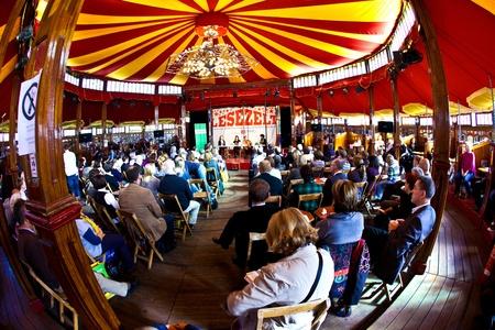 FRANKFURT, GERMANY - OCTOBER 10: public day for Frankfurt Book fair, spectators are listening the authors in the reading tent on October 10, 2010 in Frankfurt, Germany.