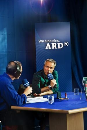 FRANKFURT, GERMANY - OCTOBER 10: public day for Frankfurt Book fair, Hannes Jaenicke, actor and activist against project Stuttgart 21 in interview  on October 10, 2010 in Frankfurt, Germany. Stock Photo - 9538741