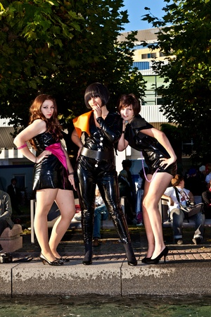 area sexy: FRANKFURT, GERMANY - OCTOBER 10: Public day at Frankfurt international Book Fair, three girls in black in costumes  are posing for photografers on October 10, 2010 in Frankfurt, Germany. Editorial