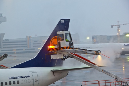 FRANKFURT - GERMANY 26: worker deices the wing of the plain in Frankfurt airport at the first frost which caused heavy delays on November 26, 2010 in Frankfurt, Germany.
