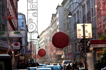 christkindlmarkt: VIENNA, AUSTRIA - NOVEMBER 26: streets in the first district are decorated with red christmas ball ornament in the shopping streets on November 26, 2010 in Vienna, Austria.