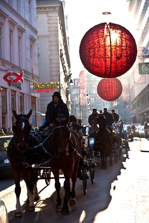 VIENNA, AUSTRIA - NOVEMBER 26: streets in the first district are decorated with red christmas ball ornament in the shopping streets on November 26, 2010 in Vienna, Austria. Stock Photo - 9541594