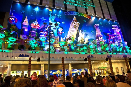 MADRID, SPAIN - DECEMBER 20: People have fun in Christmas time watching the famous puppet show and illumination at center El Corte Ingles on December 20, 2010 in Madrid, Spain.