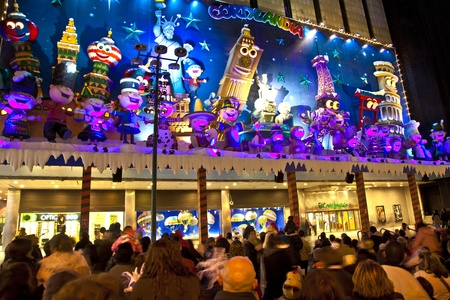 MADRID, SPAIN - DECEMBER 20: People have fun in Christmas time watching the famous puppet show and illumination at center El Corte Ingles on December 20, 2010 in Madrid, Spain. Stock Photo - 9541721
