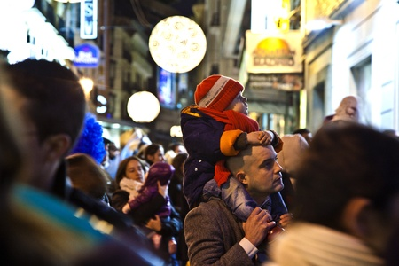 MADRID, SPAIN - DECEMBER 20: People have fun in Christmas time watching the famous puppet show and illumination at center El Corte Ingles on December 20, 2010 in Madrid, Spain. Stock Photo - 9541667