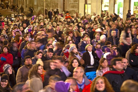 cramped: MADRID, SPAIN - DECEMBER 20: People have fun in Christmas time watching the famous puppet show and illumination at center El Corte Ingles on December 20, 2010 in Madrid, Spain.