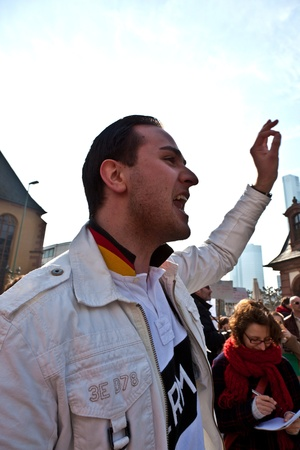 acclamation: FRANKFURT, GERMANY - March 5: People demonstrate for return of Karl Theodor zu Guttenberg into politics on March 05,2010 in Frankfurt, Germany. Guttenberg demissed his job due to his faked dissertation.