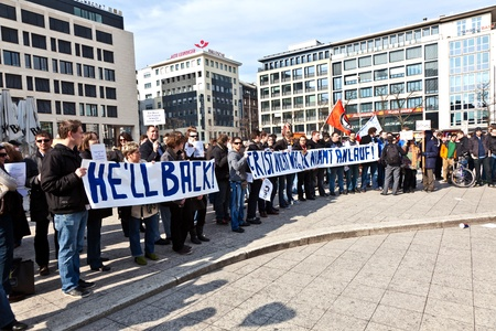faked: FRANKFURT, GERMANY - March 5: People demonstrate for return of Karl Theodor zu Guttenberg into politics on March 05,2010 in Frankfurt, Germany. Guttenberg demissed his job due to his faked dissertation.