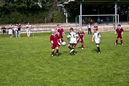 SCHWALBACH, GERMANY - SEPTEMBER 16: Football game Children E-Class Tournament - BSC Schwalbach against FC Schwalbach , September 16, 2006 in Schwalbach, Germany. Children in teckling to win the ball. Stock Photo - 9541571