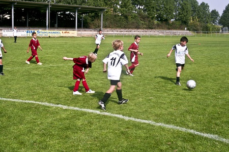 SCHWALBACH, GERMANY - SEPTEMBER 16: Football game Children E-Class Tournament - BSC Schwalbach against FC Schwalbach , September 16, 2006 in Schwalbach, Germany. Children in teckling to win the ball.
