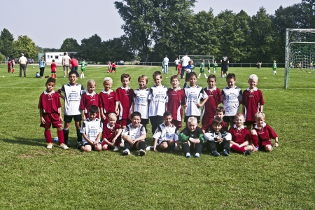 SCHWALBACH, GERMANY - SEPTEMBER 16: Football game Children E-Class Tournament - BSC Schwalbach against FC Schwalbach , September 16, 2006 in Schwalbach, Germany. Children pose proud for Team Photo.