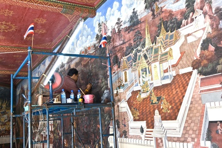 circulated: BANGKOK, THAILAND - DECEMBER 31: worker restores the famous paintings in the Grand Palace precisely with old technics  circulated since generations of handicraft painting on December 31, 2007 in Bangkok, Thailand.