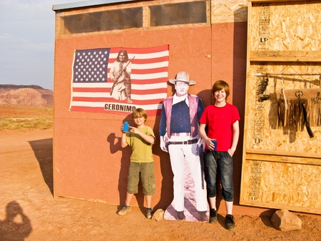 john wayne: MONUMENT VALLEY, AMERICA - JULY 12:  family is posing  with a picture of John Wayne at John Fords place in monument valley on July 12,2008. Editorial