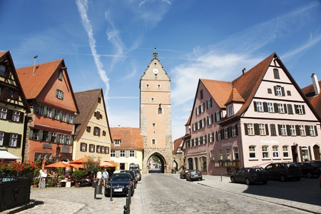 middleages: Dinkelsbuehl, GERMANY - May 13: visiting the old city Gate W�rnitzer Stadttor in Dinkelsbuehl, the city of late middleages along the romantic street,  May 13, 2010 in Dinkelsbuehl, Germany
