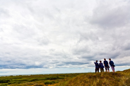 flatland: boyscouts exploring the landscape at the ocean Stock Photo