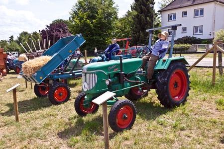 old tractors: OBERURSEL, GERMANY - June 12: old tractors at the Hessentag on June 12, 2011 in Oberursel, Germany. Hessentag is a big festival to present a city in the county of Hesse in Germany.