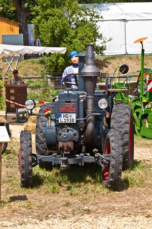 OBERURSEL, GERMANY - June 12: old tractors at the Hessentag on June 12, 2011 in Oberursel, Germany. Hessentag is a big festival to present a city in the county of Hesse in Germany. Stock Photo - 9690622
