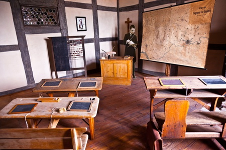 KRONBERG, GERMANY - MAY 2: old classroom of the primary school furnished  in style of 18th century in the castle Kronberger Burg on May 02, 2011 in Kronberg, Germany.