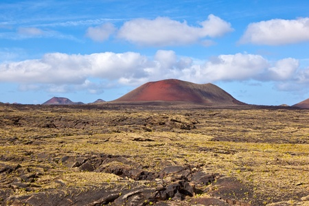 Landscape with cold lava flow and mountain in Lanzarote Stock Photo - 9746865