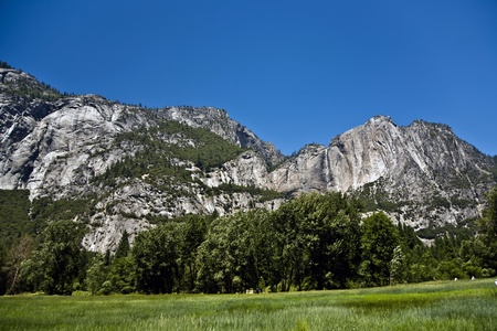 famous rock formation with waterfall in the romantic valley of yosemite park in the open countryside photo
