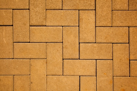 pavement pattern made with cast concrete blocks in yellow color photo