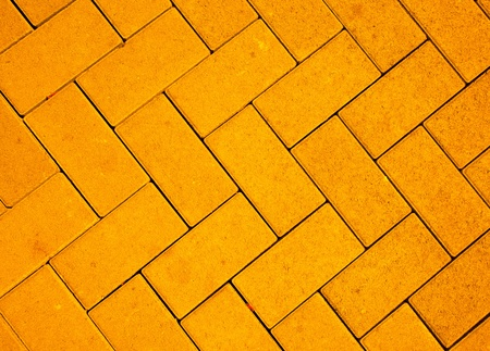 pavement pattern made with cast concrete blocks in yellow color Reklamní fotografie
