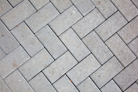 pavement pattern made with cast concrete blocks in grey color photo
