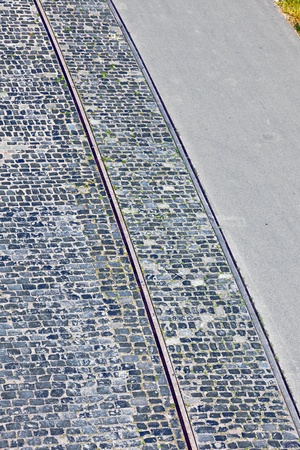 old cobble stone street with rails photo